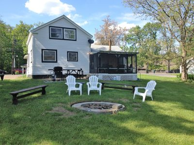 Lake side of cottage; grill, porch, fire pit, great seating and ready for you