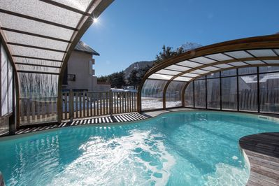 Soak up the sun by the semi-covered pool.