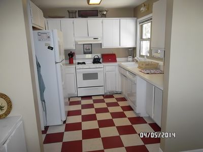 Charming kitchen - stove, refrigerator, dishwasher, microwave and coffee maker.