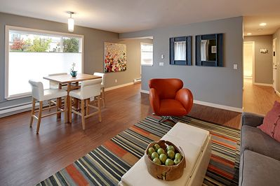 All new light filled living room with bright modern comfortable decor