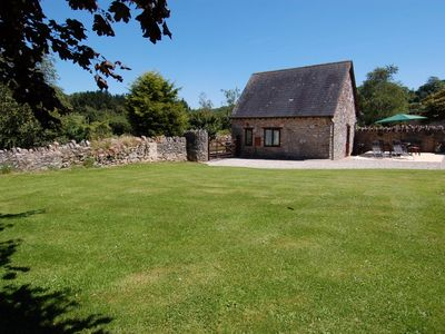 Photo for THE GARDEN COTTAGE, with a garden in Ipplepen, Ref 967208