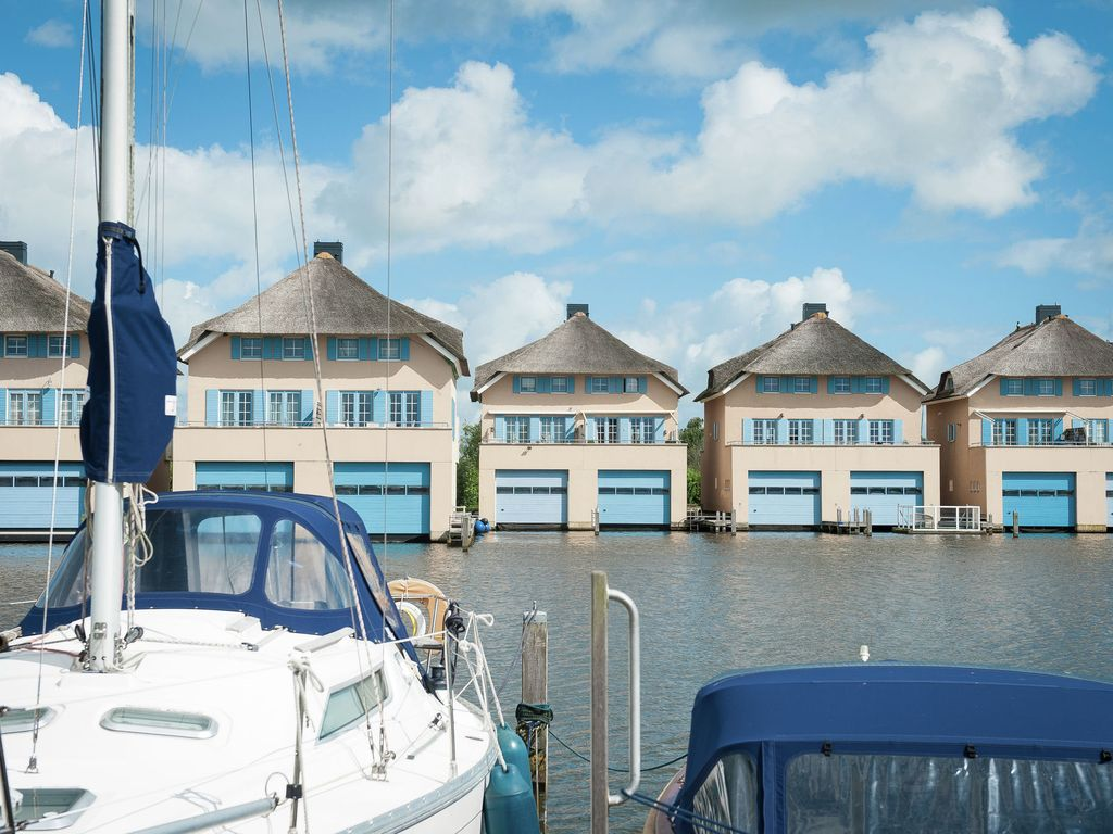 Property image1 a luxury link detached villa with boathouse and jetty close