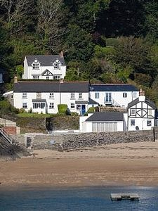 Photo for Seaweed Cottage in Fowey overlooking the beach with a garden and a parking space