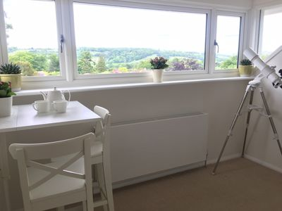 You will enjoy a panoramic view of the Surrey Hills from the picture window