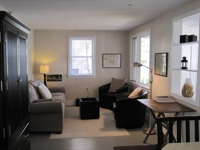 Living room with queen sized sleeper sofa.