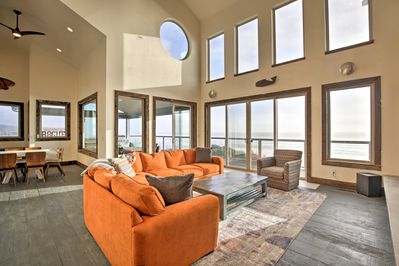 Vaulted ceilings and wall-to-wall windows open to 180-degree ocean views.
