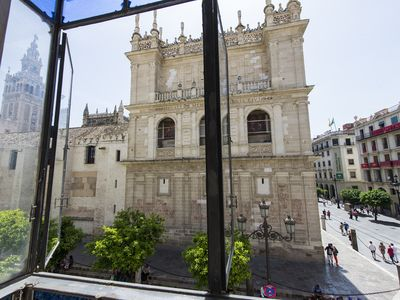 "Photo for ""LIVING BY CATHEDRAL"" 2nd - FRONT OF THE GIRALDA AND CATEDRAL - FREE WIFI AND A / C"