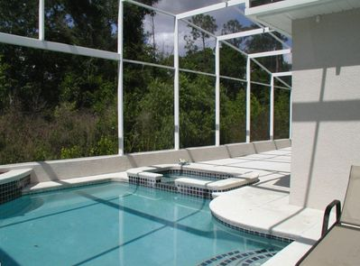 pool and spa are surrounded on two sides by conservation area for privacy