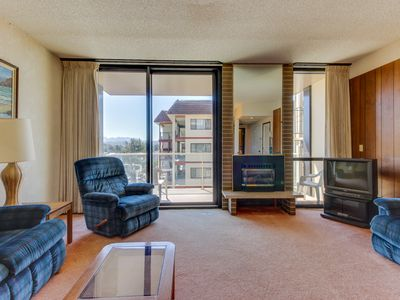 Photo for Dog-friendly condo w/ shared pool - right next to the beach