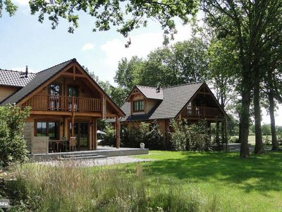 Photo for Wooden villa Tine with views over farmlands in a beautiful wooded area