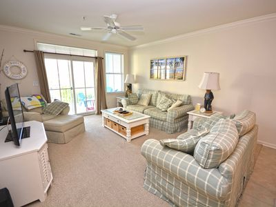 Photo for 3 Bd condo located in gated community with outdoor pool and private beach , perfect for a family vacation