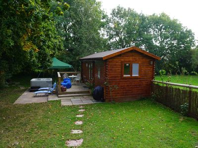 Photo for Log cabin with hot tub , dog friendly. ideal for walkers or a romantic break