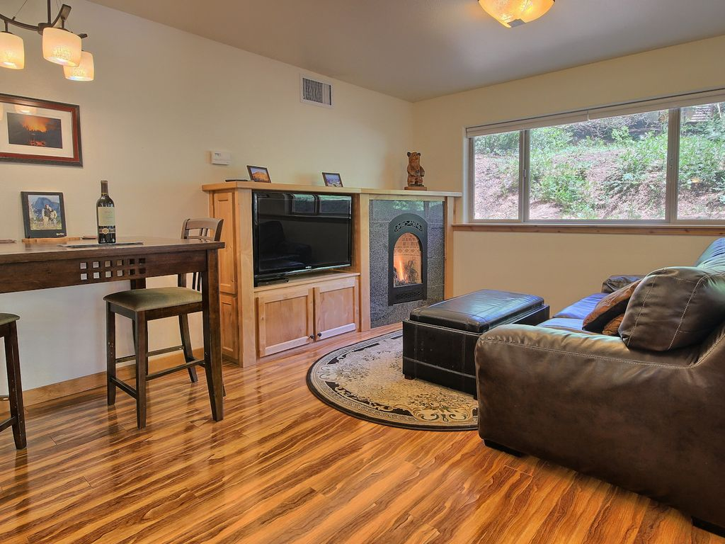 Cozy and romantic living room with 47-inch flatscreen and gas fireplace.