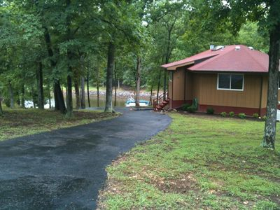 driveway into home, lake in background