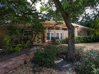 Photo for Updated mid-century modern home in charming bay-side neighborhood near downtown