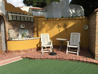 Seating area to right side of villa