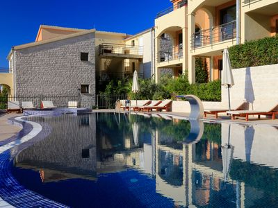 Photo for Modern Becici apartment with two pools and stunning sea views
