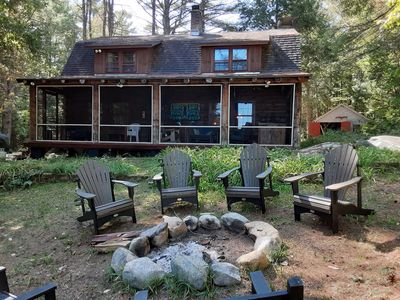 Year round lake front LOG CABIN on over 2 acres on Loon Lake updated in 2018