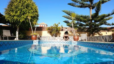 Photo for Wonderful villa with a large private heated pool and stunning views to the dunes