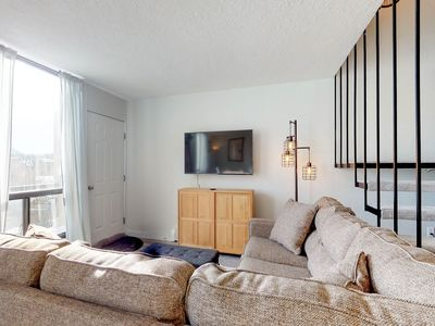 Photo for Updated condo w/ a furnished balcony w/ views & a shared hot tub - on bus route!