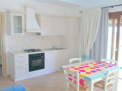 Photo for Beautiful three bedroom apartment with veranda overlooking the sea in the center of Budoni