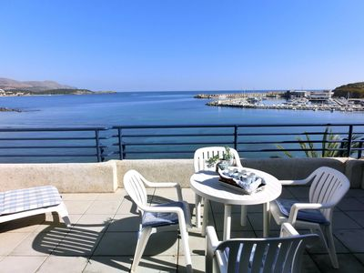 Photo for Nice top-floor apartment with large sunny terrace and beach and Llança's harbour views. S