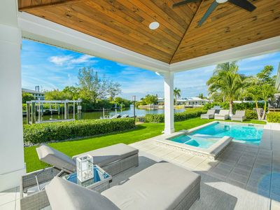 Photo for Stunning Canal front Luxury home! Beautiful tropical backyard Pool and Spa!