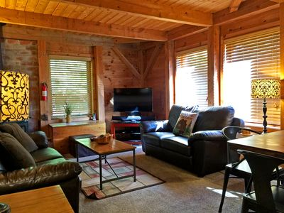 Right: Cozy living & dining room with wood burning stove and firewood included