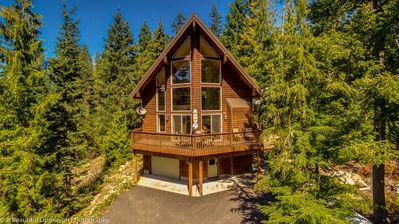 Photo for Upscale Chalet with hot tub- walk to everything- best sledding hill and WiFi!