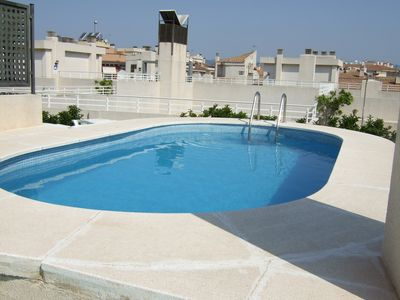 Roof top resident's private pool and sunbathing area