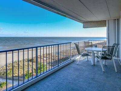 Colorful, spacious 2 bedroom oceanfront condo with WiFi, an outdoor pool, and a great ocean view located midtown and just steps to the beach!