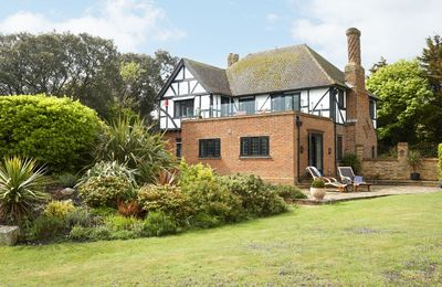 Photo for Set atop the chalk cliffs is this Edwardian home with several outdoor entertainment areas