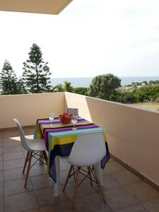 """Photo for SEAFRONT APARTMENT """"NAIADA"""" WITH VIEW OF SUNSET"""