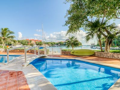 Photo for Waterfront studio w/ shared pool, on-site golf, & dock - perfect for couples