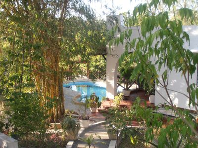 Photo for Comfortable bungalow, private swimming pool,excellent cook,near the beach,canoing,boat trips,fishing, situated in a lush tropical garden,Eco-friendly environment,