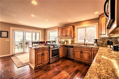 Open kitchen w/easy access to deck with grill and incredible views as you cook!
