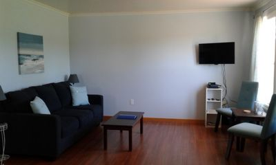 Freshly painted living room, with new décor, sofa bed, TV and DVD player.