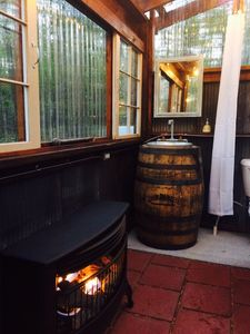 Bathhouse whiskey barrel sink and fireplace