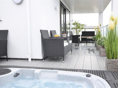 Balcony seating area with hot tub