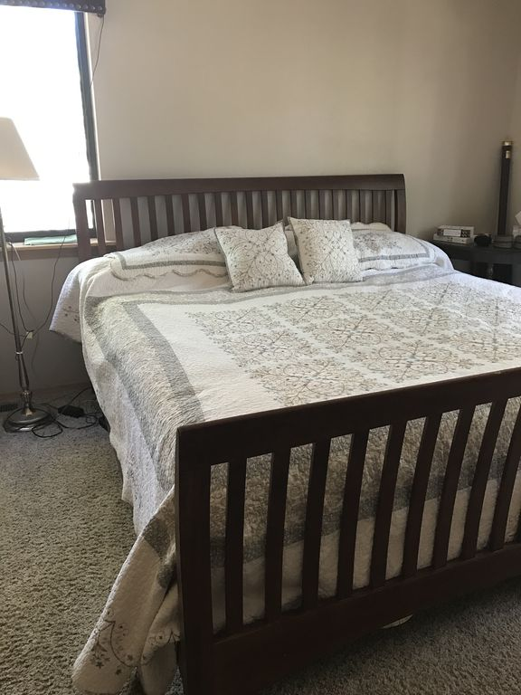 master bedroom with king size sleep number bed