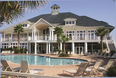 Fabulous Beach Club clubhouse with restaurant, bar, Jacuzzi, and pool.