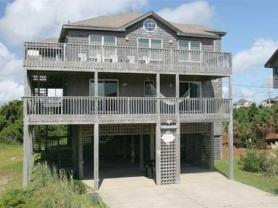 Photo for Peace & comfort! Walk to beach, dining, stores. Hot tub & hammocks!