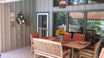 Front porch for dining with chandelier