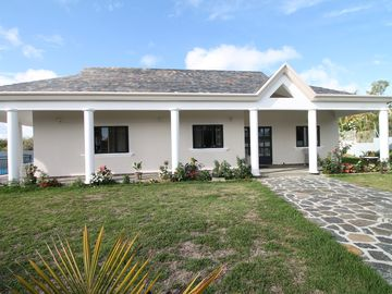 Private luxury villa with pool, spacious tropical gardens in quiet location.