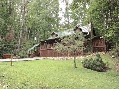 Photo for Rustic Log Cabin near ski slopes and swimming pools