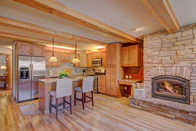 Trollhagen 5 - a SkyRun Breckenridge Property - Living room opens to a modern, well stocked kitchen