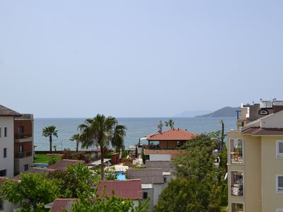 Photo for Sunset C9. Calis beach front apartment with shared pool