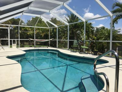 Photo for Tropical 3BR Cape Coral Canal Front Home w/private solar heated pool