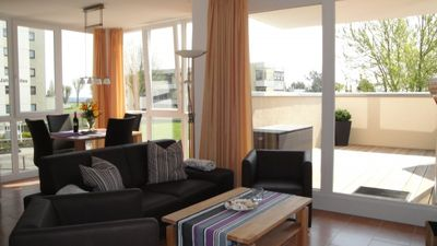 Photo for Fantastic apartment with sauna, fireplace, two wooden terraces and sea views