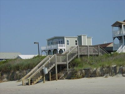 Public stairs over dunes, then 1-way street, house
